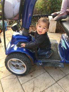 Alon, enjoying Savta's sweet ride, her scooter