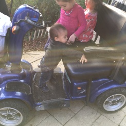 Alon, trying to get on the seat with the big kids!