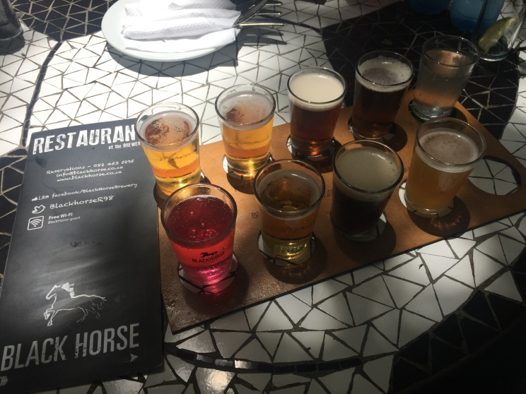 Yum, beer flight. (And yes, the pink one was a beer - it was a strawberry-infused ginger beer! (I know true beer drinkers would say that wasn't actually beer...)