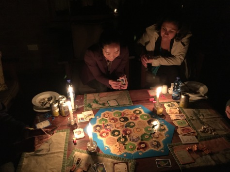 Maria, concentrating very hard... (Catan by candlelight!)