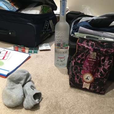 The essentials to take on the plane - Trader Joe's chocolate-covered pretzels and Belvedere!