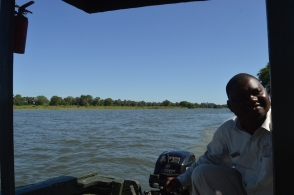 Our awesome guide, Chifundo, and the beautiful river behind us.