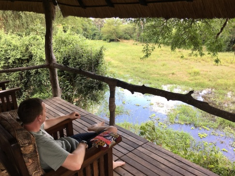 Jon on the porch just off of our room - we watched animals hang out there every day!
