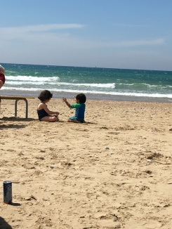 Cousins playing on the beach - yahoo!