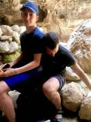 Better to sit on your dad than on a rock...