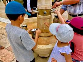 Washing their hands before going to the Wailing Wall...