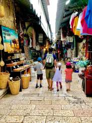 Tackling the narrow streets of the shuk...