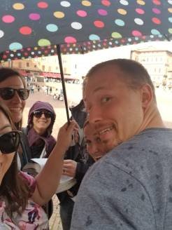 Crowded under our one umbrella, while enjoying our dinner and gelato in Il Campo!