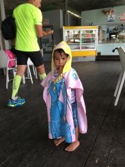 This kid ROCKS a Disney towel-dress...
