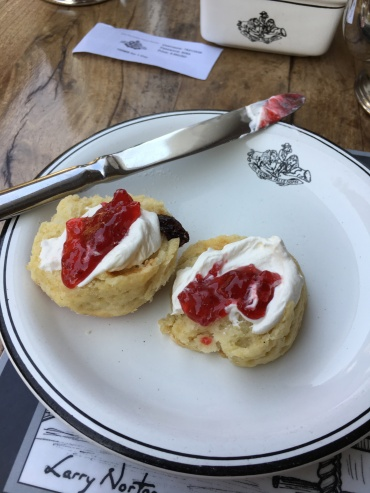 We were coached on this - clotted cream *then* jam. Yum.